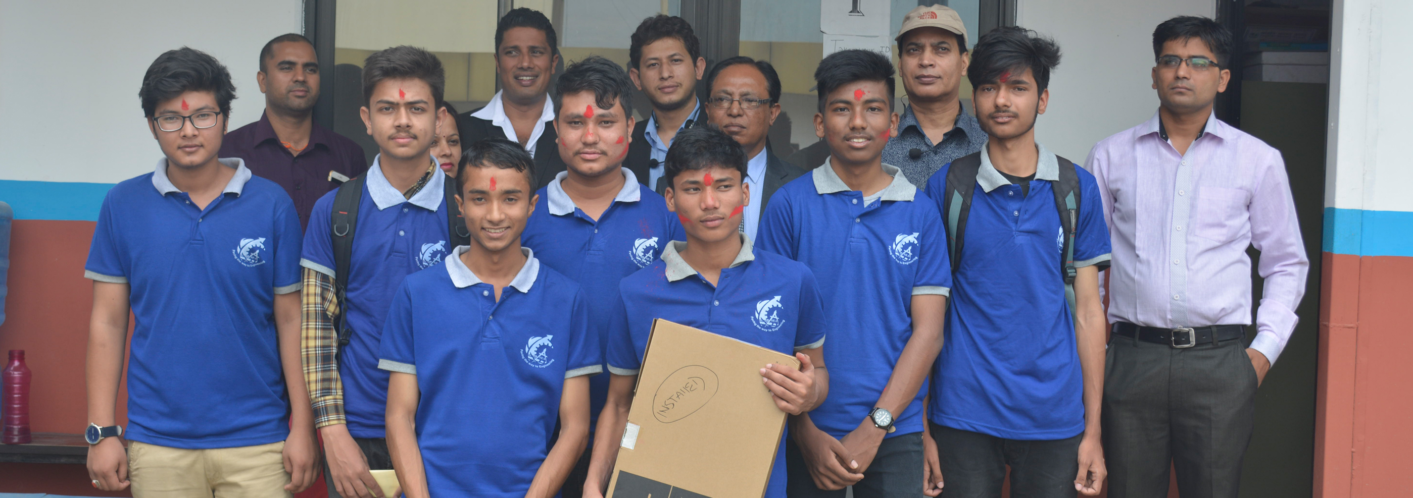 Scholarship Test Toppers: Prize Distribution Ceremony. Mr. Nishant Singh receiving a laptop